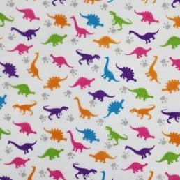 Colourful Dinosaurs on White PolyCotton Fabric