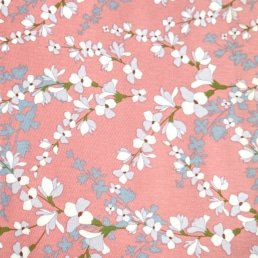 Blossoms on Coral Cotton Fabric