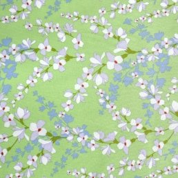 Blossoms on Soft Lime Cotton Fabric